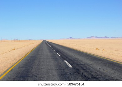Straight African tarmac highway in open Namib Naukluft desert, Namibia, Africa. Oldest desert of the world
