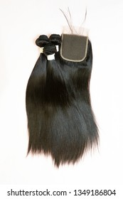 Straight black virgin human hair extensions bundles with 4x4 lace closure - Image - Shutterstock ID 1349186804