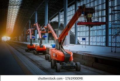 The straight Boom lift to construction roof rail train station platform park on site of  railway construction .