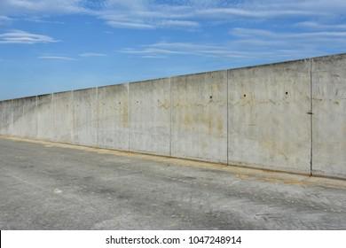 straight concrete border or prison wall