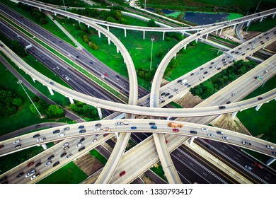 Straight down aerial drone view looking down from above Interchange highway overpass development roads loops mopac expressway in Austin Texas USA green Texas hill country landscape urban connection