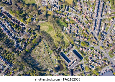 Straight down aerial photo of the British town of Meanwood in Leeds West Yorkshire showing typical UK housing estates and rows of houses in the spring time on a sunny day - Shutterstock ID 1961182033