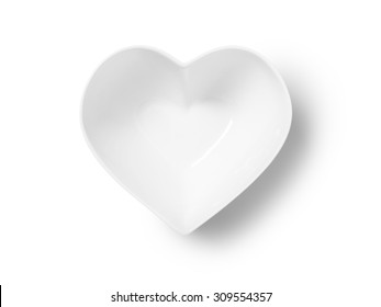 Straight down, birds eye shot of an empty heart shaped bowl or plate on a pure white background with a clipping path and copy space.