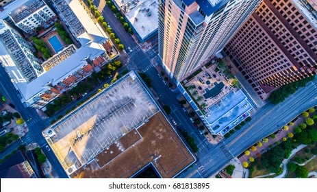 Straight down drone view above Austin Texas USA above hotels and skyscrapers and square office buildings , condos and indoor courtyard with swimming pool urban Austin luxury