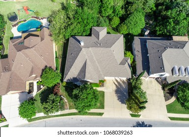 Straight down view Green Landscape and Luxury Homes in Spring time green aerial drone view of Suburb Houses and suburbia neighborhood in Cedar Park , Texas