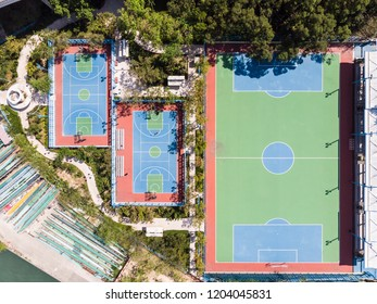 Straight down view of synthetic football and basketball pitch surface in Ap Lei Chau in Hong Kong, China