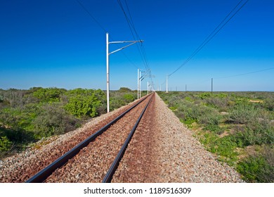 Straight electrified, single track, narrow gauge railway on Sishen Saldanha line in South Africa