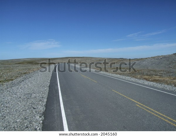 Straight, empty and remote road in Scandinavia.