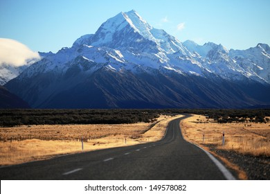 Straight empty road to Mount Cook National Park, New Zealand
