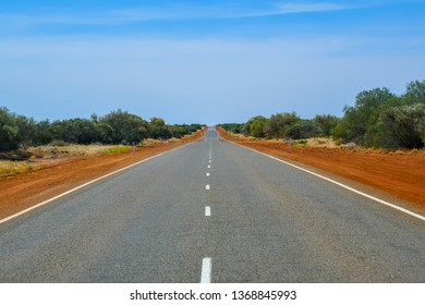 Straight endless empty road in Western Australia in the Outback