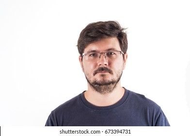 Straight up face of caucasian man with Disheveled hair and glasses