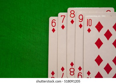 straight flush poker cards combination on green background casino game fortune luck
