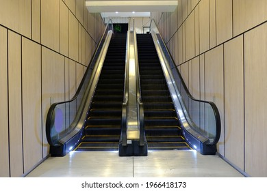 Straight front angle of indoor escalators in a clean, generic modern environment. For advertising mockup purpose, eg sticker wrap on wall or stairs
