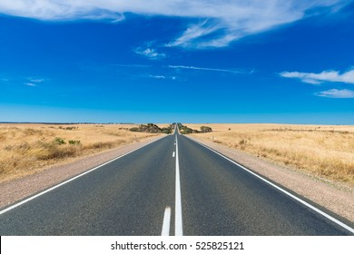 Straight line Australian highway in rural outback, Remote countryside landscape