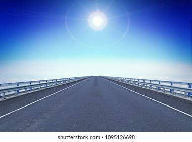Straight motorway with a guiding star over horizon. Concept of moving forward