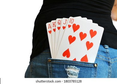 Straight playing cards in the rear pocket of a lady in Jeans