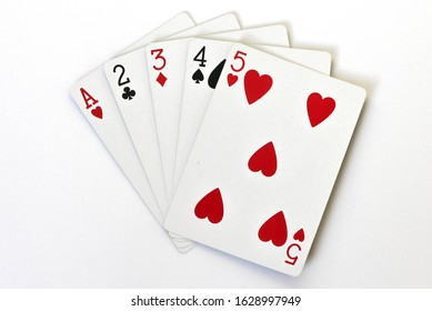 A straight poker hand with playing cards, different suits