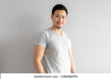 Straight portrait of Asian man with a bit of smile.