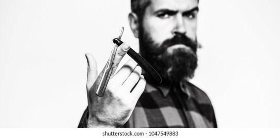 Straight razor, barbershop, beard. Barber scissors. Mens haircut. Man in barbershop. Bearded man, lush beard, handsome. Hipster, brutal male. Barber shop. Vintage straight razor. Black and white.