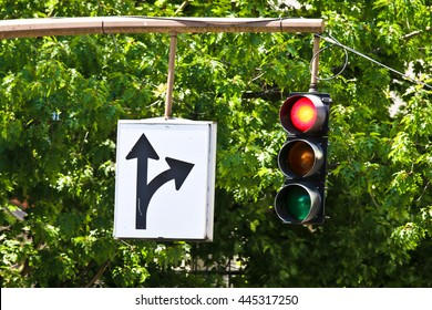 Straight or right turn sign with red signal light