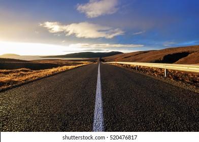 Straight road across the desert in Iceland, Sunset HDR