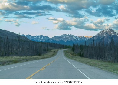 Straight road ahead in the Canadian Rockies along the Icefields parkway in Alberta, Canada