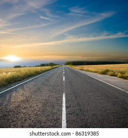 straight road and colorful sunset