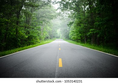 A straight road in a forest on Blue Ridge parkway, Virginia.