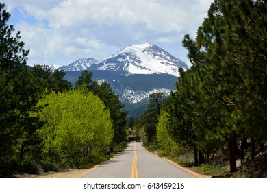 A Straight Road Pointing to Snow Covered Copeland Mountain in Rocky Mountain National Park