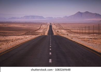 Straight road running through the hot Namibian desert.