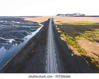 Straight road through Icelandic landscape. Taken by a drone.