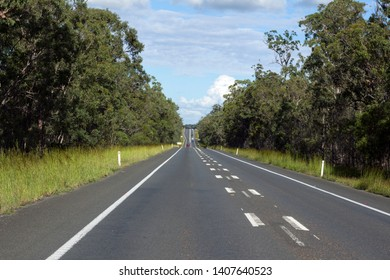 A straight section of a two lane highway in rural Australia showing an upcoming overtaking lane.