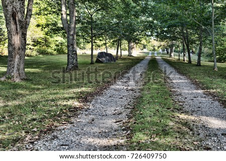 straight shaded gravel rutted road leading stock photo edit now