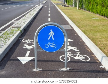 Straight two way cycle lane with traffic street signs.