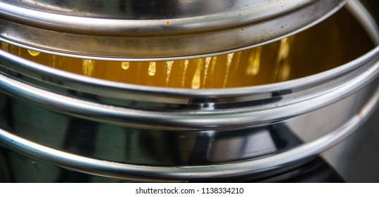 Strain the poured honey through a sieve. How to Harvest Honey. Filtering raw honey, France