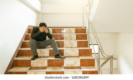 A strained businessman sat on the front door of his room because of unemployment during the Covid 19 virus epidemic.