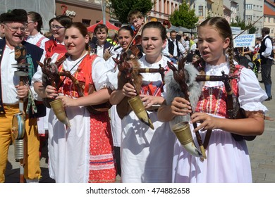 "STRAKONICE, CZECH REPUBLIC - AUGUST 28, 2016: Girls of the Czech bagpipe band ""ZUS STRAKONICE"" parade on the 22th International Bagpipe Festival."
