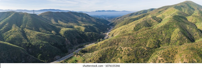 Strand of gray asphalt leads through the quiet narrow valleys of southern California's Canyon Country.