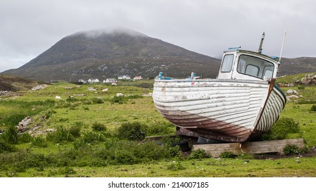 Stranded boat on a Scottish green field.Isle of Harris, Outer Hebrides, Scotland, UK.