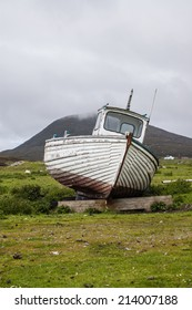 Stranded boat on a Scottish green field.