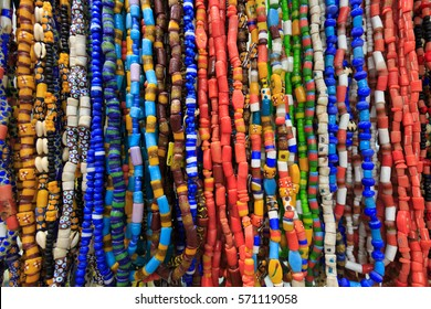 Strands of small colorful beads necklaces