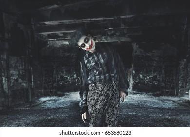 strange creepy clown standing