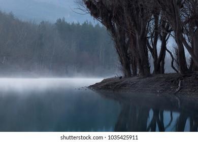 'Strange dawn': foggy morning at a mountain lake, Crimea