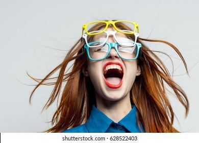 Strange fashion woman portrait with glasses, colored glasses