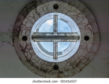 strange and futuristic concrete round shape design on the ceiling. The windows without glass.