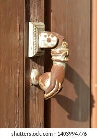 strange knocker on old wooden door