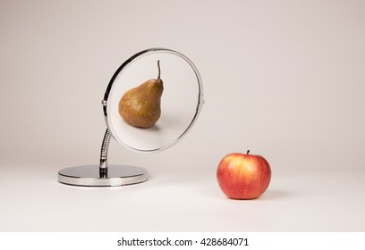 Strange mirror reflecting apple and pear