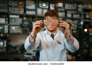 Strange scientist looks through the glasses in lab