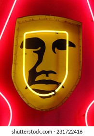 Strange vintage signage with neon light highlighting facial imagery