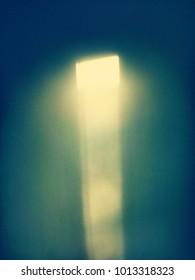 strange yellow light on a green wall